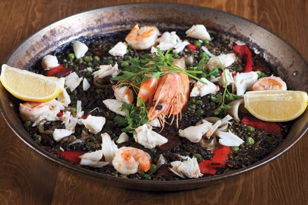 Toros' paella negra is black rice laced with shrimp, squid and crab meat.