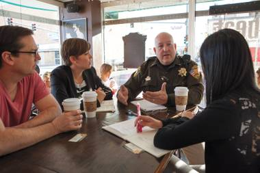 Meeting of minds: David Gould, left, Lindsay Hyde and Amy An, right, meet with Lt. Harry Fagel at the Beat.
