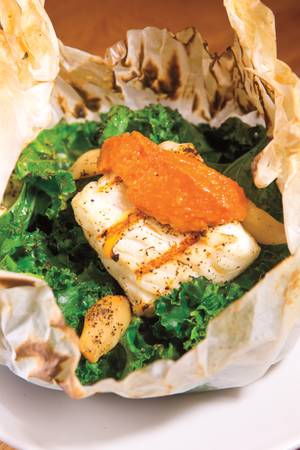 Crush's California sea bass with braised kale and tomato chutney.