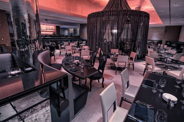The new semi-private table in the center of N9NE Steakhouse is shrouded in sheer drapes and topped with a chandelier.