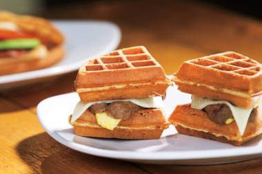 Fluffy waffles layered with sausage, egg and cheese make up Tiabi's signature Hashtag breakfast sandwich.