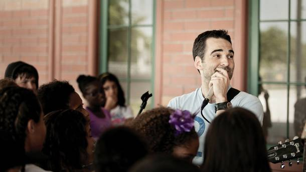School in session: Allen talks music at Orlando's Andover Elementary School.