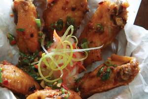 Tamarind-glazed chicken wings are a solid starter for any meal at District One.