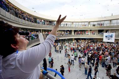Not-so-humble beginning: Zappos employee Ana Santiago catches confetti during the grand opening of Zappos' Downtown location in 2013.