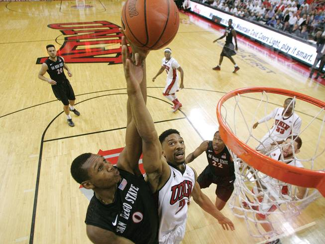 UNLV's Khem Birch blocks a shot from San Diego State's Skylar Spencer in their Mountain West Conference game last week.