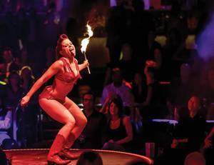 All fired up: Angie Sylvia burns her costume off during <em>Vegas Nocturne</em>'s midnight show.
