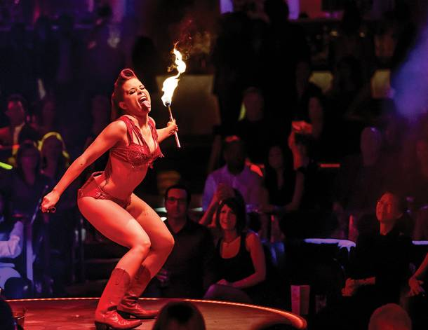 All fired up: Angie Sylvia burns her costume off during Vegas Nocturne's midnight show.