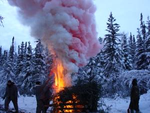 "S.E.R.E. guys build a ""smoke generator"" signal fire during arctic survival training near Fairbanks, Alaska. A smoke generator this size can generate a column of smoke several hundred feet high that lasts up to 20 minutes."