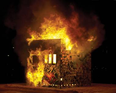 """Once the fire was lit, the cube was quickly engulfed and collapsed into itself in minutes."""