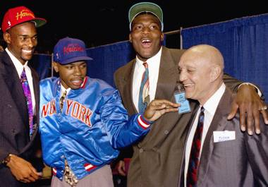 Rebel pride: Former UNLV players (from left) Stacey Augmon, Greg Anthony and Larry Johnson, with then-coach Jerry Tarkanian.