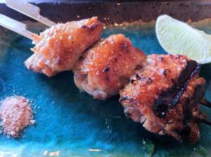 Yusho's remarkable grilled chicken wings are boneless, smoky and delicious, served with lime and bonito salt.