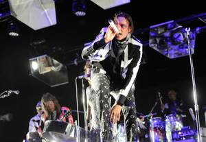 "Coachella Day 3 headliners Arcade Fire shouted out the bands ""still playing instruments."""