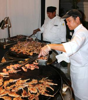 Chefs from Samba Brazilian Steakhouse grill lamb chops at UNLVino's Bar-B-Q event.