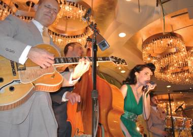 The Jennifer Keith Quintet plays regularly from the first floor of Cosmo's sparkling centerpiece.