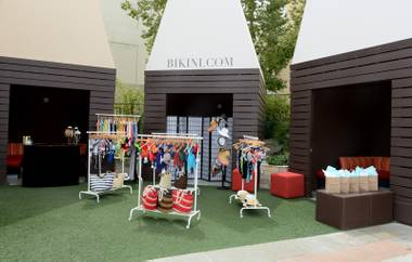 Shop the Bikini.com pop-up at Palms Pool for a hot look, then accessorize with a cool beverage.