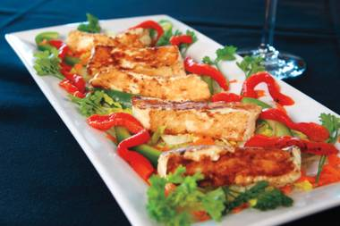 Vila Algarve's grilled halloumi cheese, served with a slightly spicy peri peri sauce, is a must-try dish.