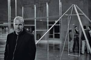 Mark Brandvik with his <em>Green Felt Jungle Gym</em> exhibit