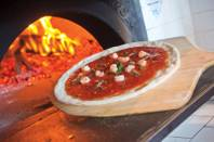 The Napoletana pizza, with anchovies, shrimp, capers, garlic and oregano, hits the oven at 800 Degrees.