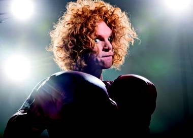 Carrot Top and several other Las Vegas entertainers are featured in a new series of videos that began airing this week at McCarran International Airport. Carrot Top's message? No joking at the checkpoint, guys.