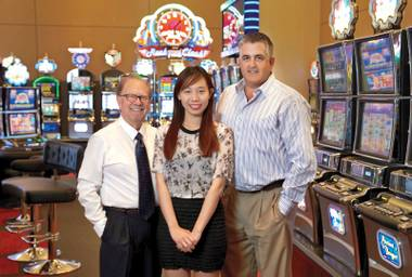 Big idea: Gaming Innovation Program student Nguyen (center) sold a game she co-invented with professor Yoseloff (left) to Konami Gaming.