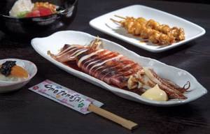 Whole grilled squid plus chicken skin skewers add up to a delicious nosh at Izakaya Cocokala.