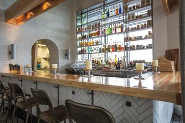 The Scullery gets much of its charm from bartenders Calvin Perreira & Claudia Torres.