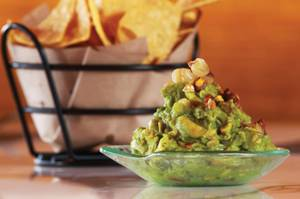 Start your Mercadito experience with the bacon, hominy and habanero-fueled <em>tocino</em> guacamole.