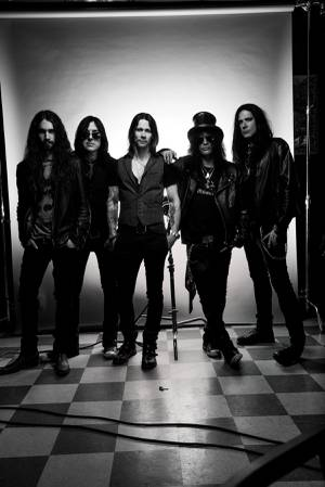 Frank Sidoris, left, stands with Slash featuring Myles Kennedy and the Conspirators.