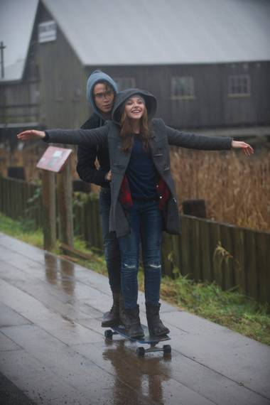 Another teen romantic drama, another scene in the rain. Chloë Grace Moretz and Jamie Blackley in If I Stay.