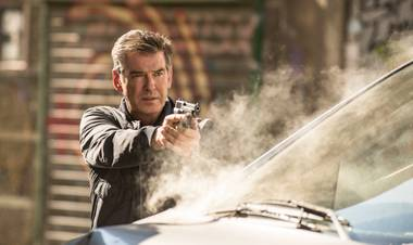 Brosnan isn't James Bond, but the comparisons are unavoidable.