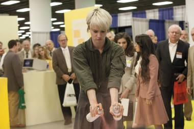 Conventional behavior: Cameron (Mackenzie Davis) gets creative on the COMDEX floor in AMC's Halt and Catch Fire.
