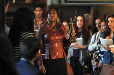 Viola Davis holds the trophy given to the most ludicrous plot twist in How to Get Away With Murder.