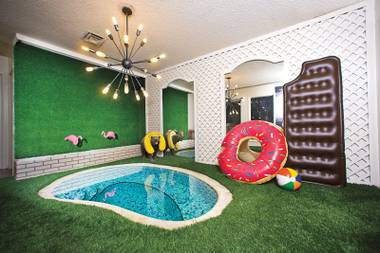 "Jennifer Emil's ""pool room""—featuring AstroTurf and a Sputnik chandelier—fits her personality perfectly, she says."