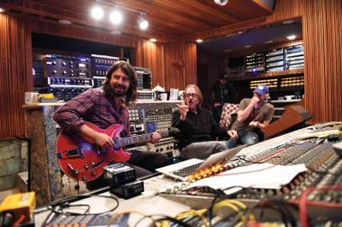 Dave Grohl, and producer Butch Vig (center) work on a song.