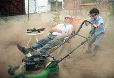 Bill Murray and Jaeden Lieberher do yard work in St. Vincent.