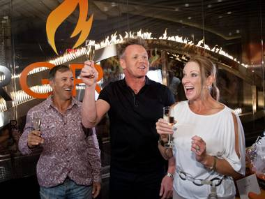 Gordon Ramsay toasts with the lucky couple who ordered his millionth BurGR.