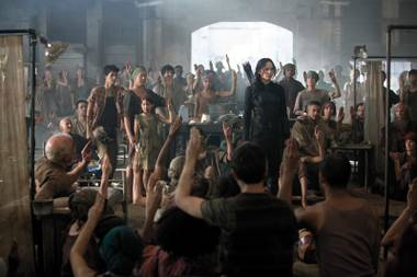 Salute: Katniss inspires the soldiers of the rebellion in The Hunger Games: Mockingjay - Part 1.