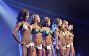Las Vegan Stephanie Brewster, left, poses in a final lineup during the Fitness America Weekend 2014 at the Golden Nugget.
