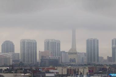 Foggy weather veils the top of the Stratosphere in this skyline shot of the city on December 4, 2014.