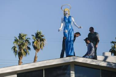 Ali Fathollahi places the Blue Angel sculpture