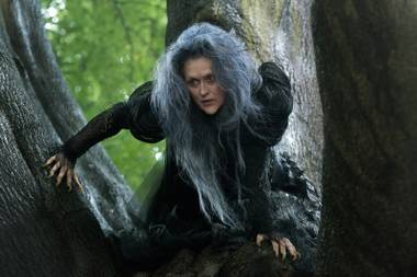 Meryl Streep prowls the fairy-tale forest in the half-great Into the Woods.