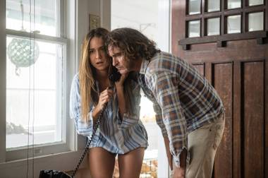 Katherine Waterston and Joaquin Phoenix in Inherent Vice.
