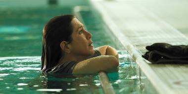 Jennifer Aniston ponders life's unfairness while swimming.