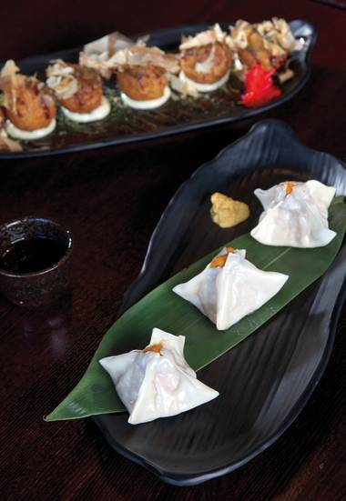 Uni shumai and takoyaki are must-eat dishes at Go.