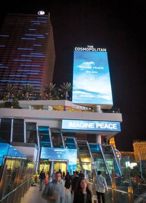 "Yoko Ono's ""Imagine Peace"" digital artwork adds to the Strip's visual landscape on the Cosmopolitan marquee."