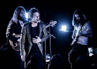 The Killers' frontman only plays three new songs from upcoming solo album The Desired Effect.
