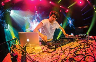 Porter Robinson, shown DJing in Vegas, unleashed a dramatic live show at Coachella.