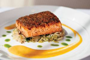 Scottish salmon is topped with Serrano ham and a sweet-spicy glaze.