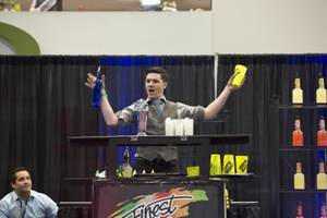 "Mike Mills, of Pittsburgh, competes in the ""Shake It Up!"" Flair Competition at the 2015 Nightclub & Bar Show, Tuesday March 31, 2015."