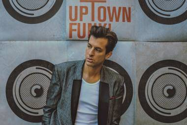 Mark Ronson mixes it up at Cosmo's club Friday.
